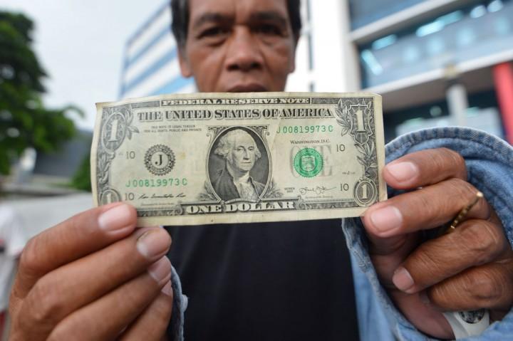 Rupiah Ditutup Melemah ke 16.575/USD