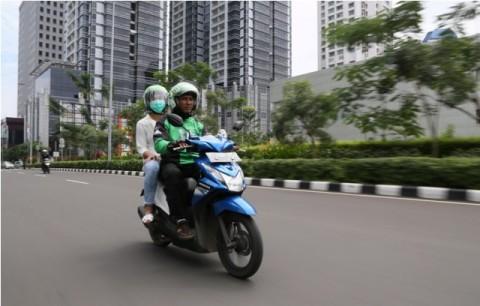 Polisi Imbau <i>Bikers </i> tak Gunakan <i>Phone Holder </i>