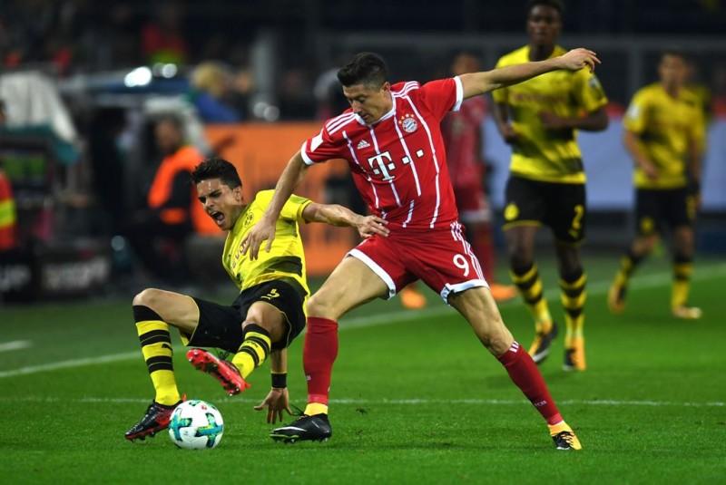 Pertemuan terakhir kedua tim di ajang Piala Super Jerman (AFP PHOTO / PATRIK STOLLARZ)