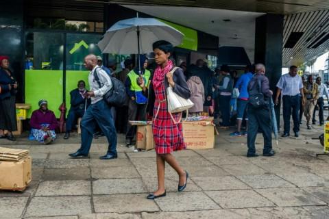 Stunned Zimbabweans Face Uncertain Future without Mugabe