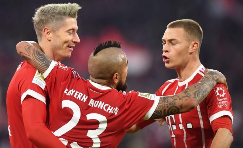 Pemain Bayern Muenchen meraih kemenangan atas Augsburg. (Foto: AFP/Christof Stache)