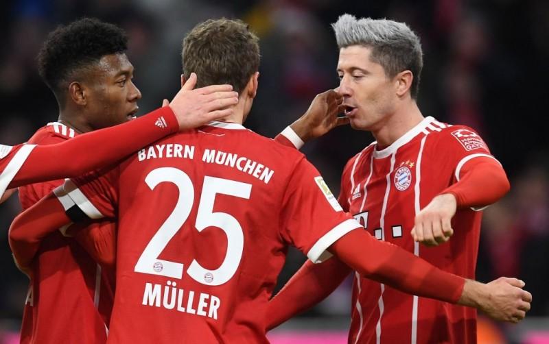 Robert Lewandowski (kanan) mencetak satu-satunya gol kemenangan untuk Bayern Muenchen atas Koeln (Foto: AFP/Christof Stache)