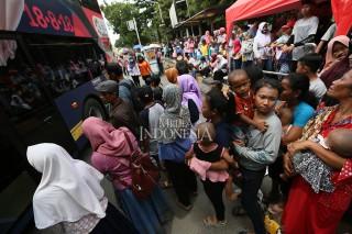 Antrean Penumpang Bus Tingkat Jakarta Mengular