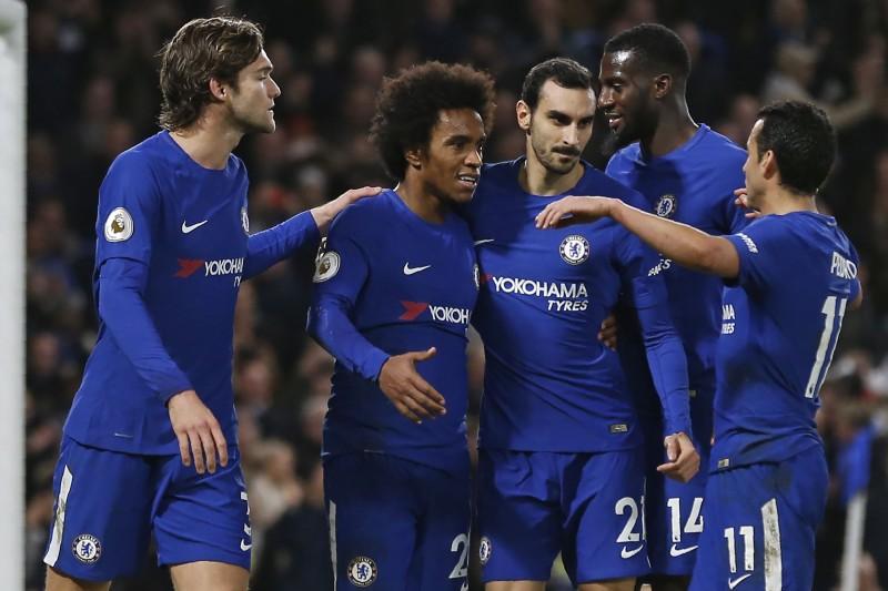 Selebrasi gol para pemain Chelsea. (AFP PHOTO / Ian KINGTON)