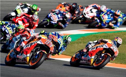 Suasana balap di seri MotoGP Valencia (AFP PHOTO / JOSE JORDAN)