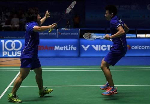 Chen Qingchen (L) dan Zheng Siwei sukses menyingkirkan Praveen