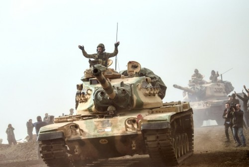 Turkish troops advance near the Syrian border at Hassa, in an