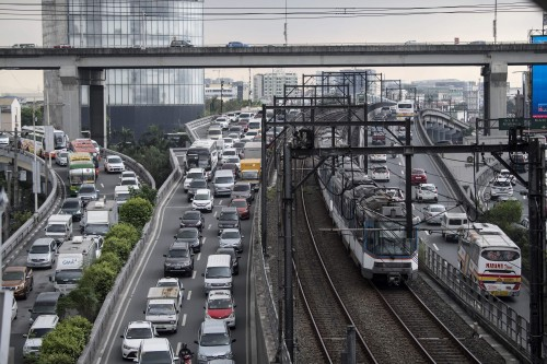 This general shot shows vehicles stuck in traffic in Manila on