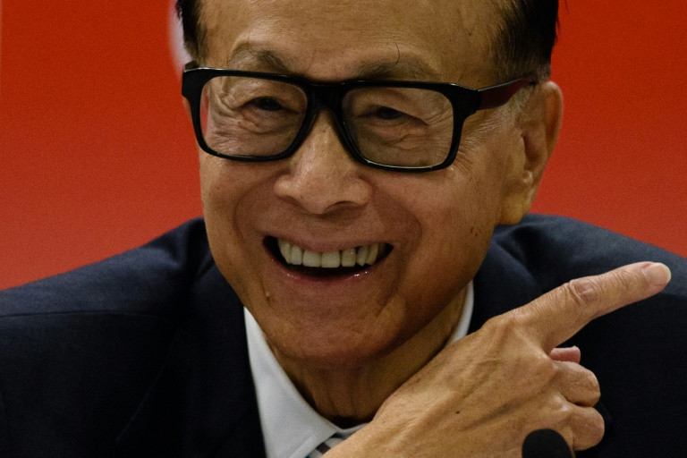Hong Kong's richest man Li Ka-shing was dubbed Superman for his business acumen. (Photo:AFP/Anthony Wallace)