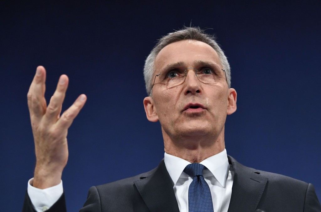 NATO Secretary-General Jens Stoltenberg gestures as he addresses a press conference to give the alliance's annual report at NATO headquarters in Brussels on March 15, 2018.  (Photo:AFP/Emmanuel Dunand)