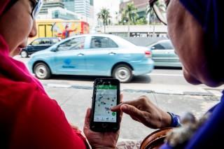 Grab Caplok Operasi Uber di Asia Tenggara