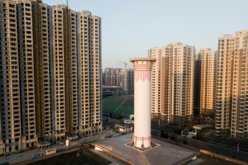 Standing between high-rises, the giant air purifier is capable