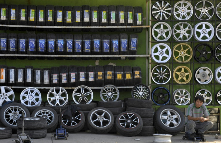 China announces it will impose temporary anti-dumping measures on synthetic rubber imported from the United States, the European Union and Singapore. (Photo:AFP/Liu Jin)