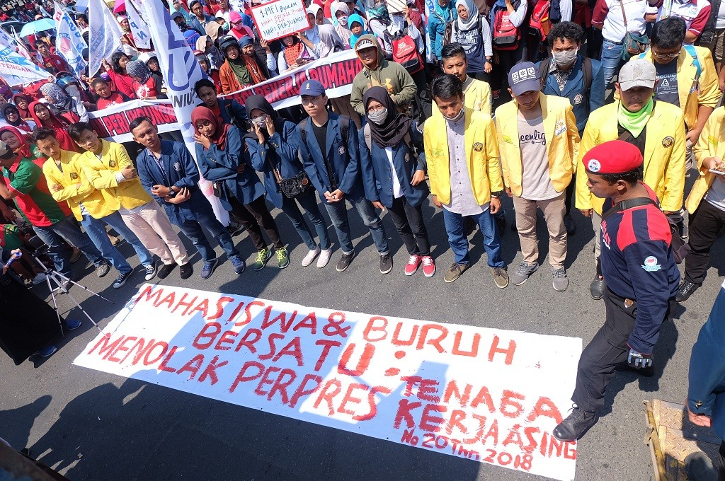 Aksi buruh dan mahasiswa di Kota Semarang menolak tenaga kerja asing, Selasa 1 Mei 2018, Medcom.id - Budi Arista