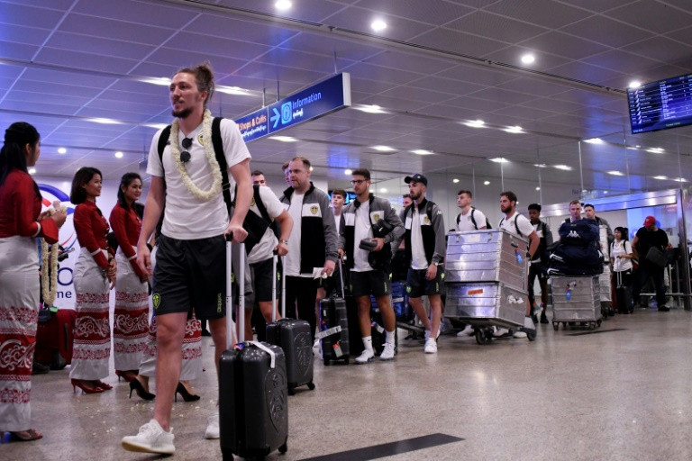 The players refused to answer any questions on the issue as they walked out of Yangon airport alongside saffron-robed monks, dreadlocked backpackers and a handful of diehard Leeds fans who had joined their team for the trip. (Photo:AFP/Ye Aung Thu)