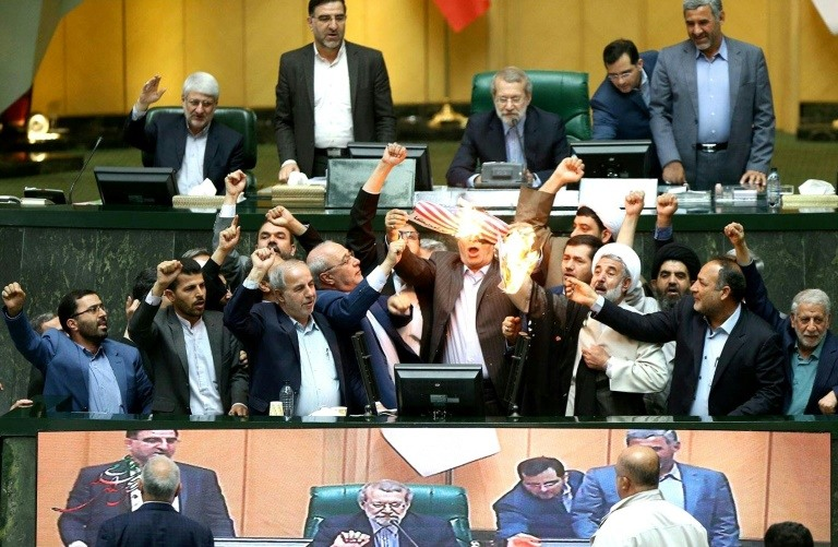 Iranian MPs burn a US flag in parliament in Tehran on May 9, 2018. (Photo:AFP/Islamic Consultative Assembly News Agency)