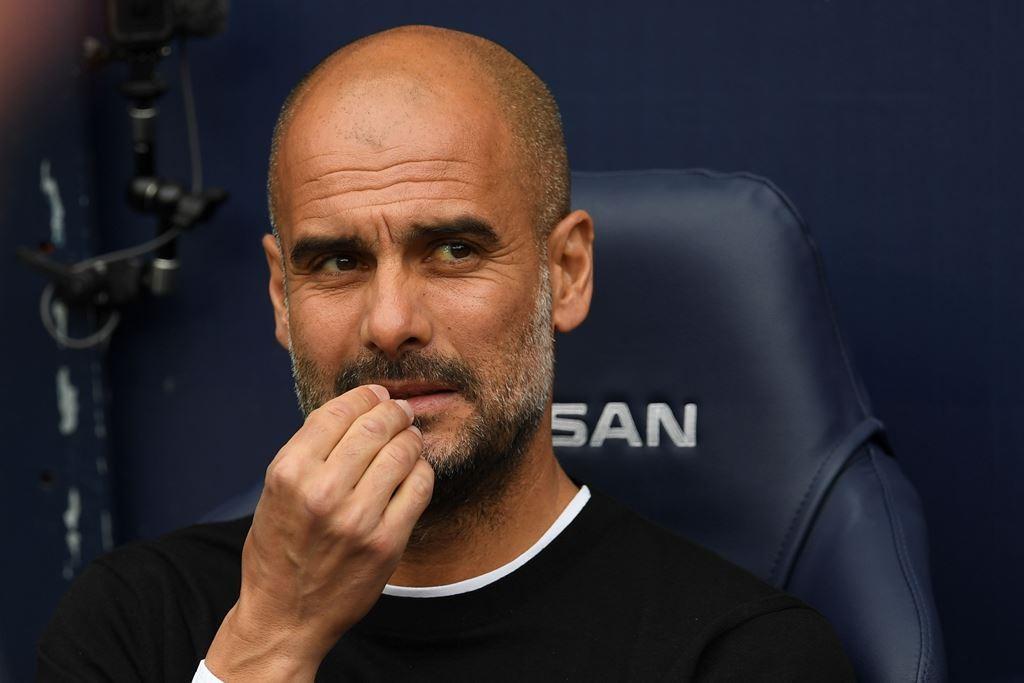 Pep Guardiola ( Foto AFP/PAUL ELLIS)