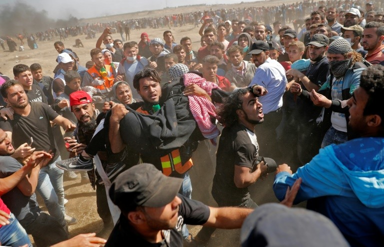 At least 55 Palestinians were killed on Monday with more than 2,400 wounded. (Photo:AFP/Thomas Coex)