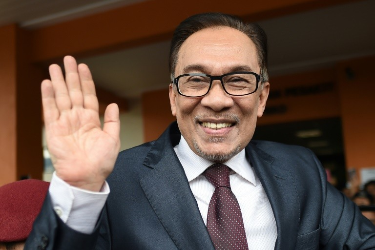 Anwar, now 70, was granted a royal pardon over a sodomy conviction that saw him jailed for the past three years. (Photo:AFP/Mohd Rasfan)