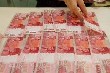 Rupiah Pagi Turun Tipis ke Rp14.143/USD