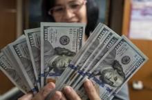 USD Tergelincir Akibat Investor Pertimbangkan Risalah Pertemuan Fed