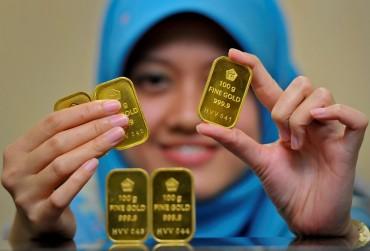 Emas Antam di Akhir Pekan Bersinar di Rp667 Ribu/Gram