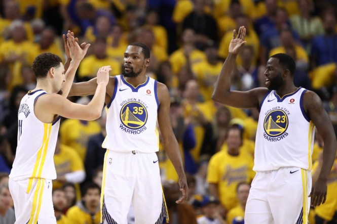 Para pemain Golden State Warriors (Foto: AFP/Ezra Shaw)