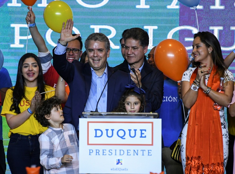 Conservative Colombian presidential candidate Ivan Duque celebrates after his first-round win. (Photo:AFP/Luis Acosta)