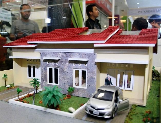 Maket kompleks perumahan dalam sebuah pameran properti. file/Antara Foto/Rekotomo