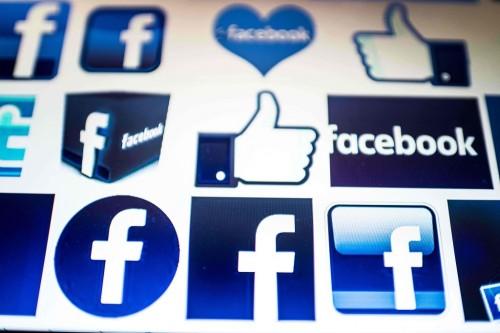Facebook terus perangi hoaks. (AFP PHOTO / NICOLAS ASFOURI)