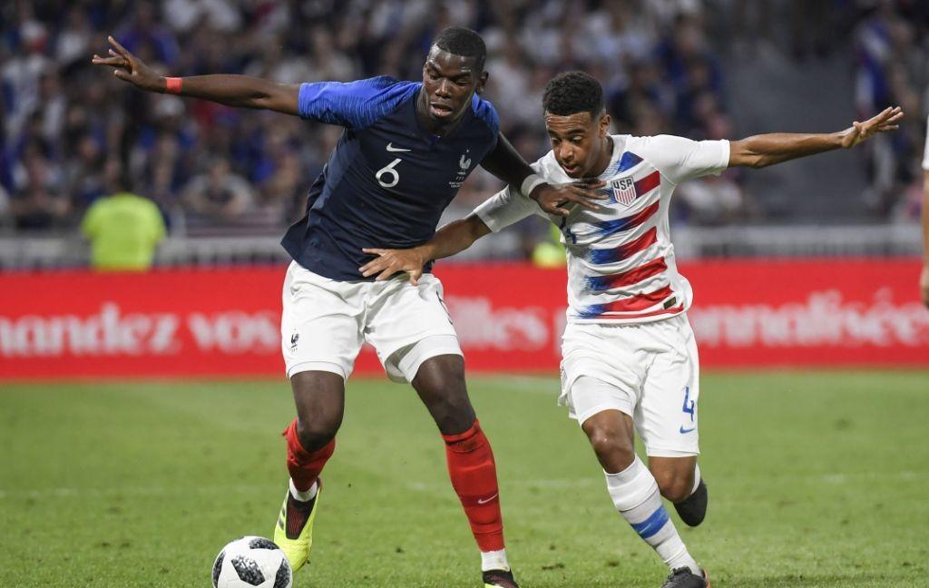 Paul Pogba (kiri) (Foto: AFP/Philippe Desmazes)