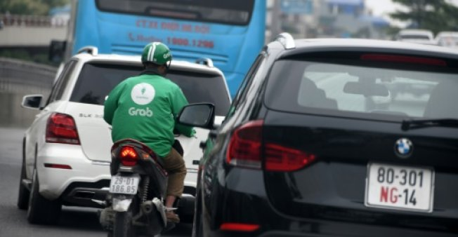 Grab, which is headquartered in Singapore, is a leading player in the ride-share industry in Asia, and earlier this year agreed to acquire US giant Uber's regional operations. (Photo:AFP/File)
