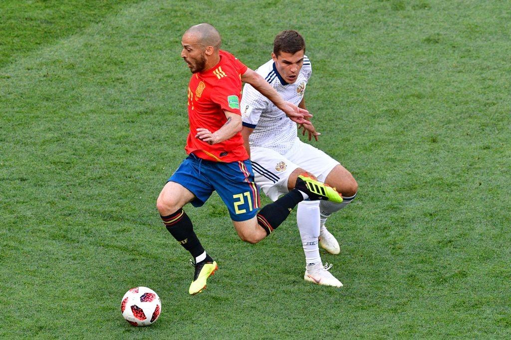 Laga Spanyol kontra Rusia di babak 16-besar Piala Dunia 2018, Minggu (1/7) (AFP PHOTO / Mladen ANTONOV)