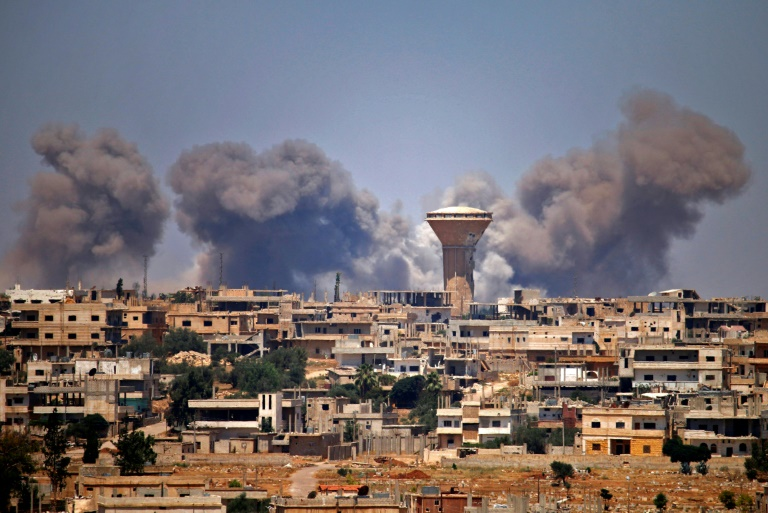 Smoke rises above rebel-held areas of the city of Daraa during reported air strikes by Syrian regime forces on July 5, 2018. (Photo:AFP/Mohamad Abazeed)