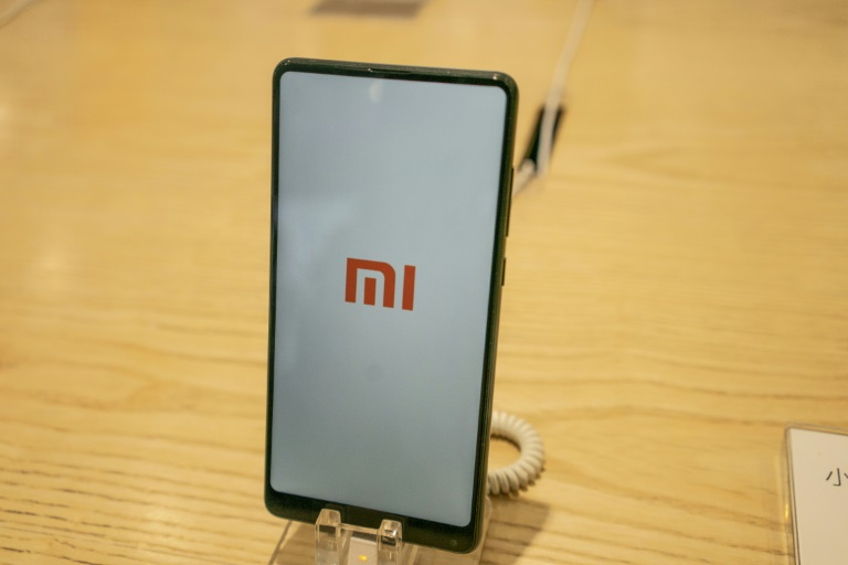 Despite being one of the most anticipated Chinese technology IPOs this year, Xiaomi saw a disappointing valuation of US$54 billion, well below its ambitious US$100 billion target. (Photo:AFP/Fred Dufour)