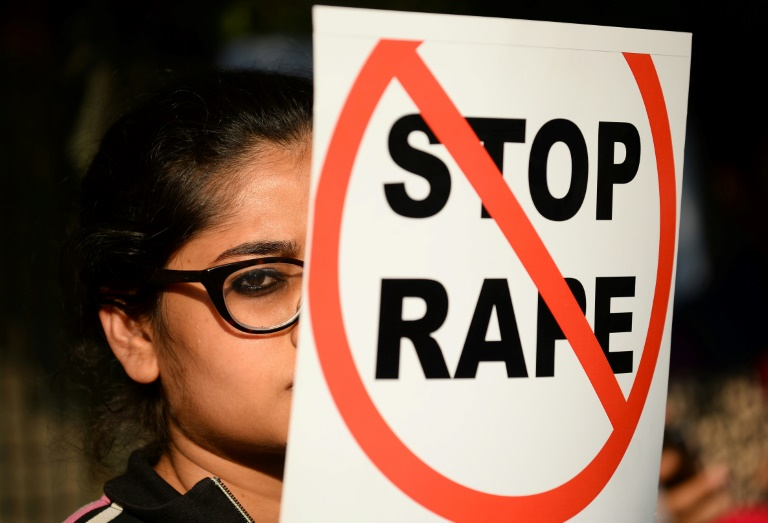 An Indian social activist holds a placard during a protest against a rape in New Delhi on February 21, 2017. (Photo:AFP/Sajjad Hussain)