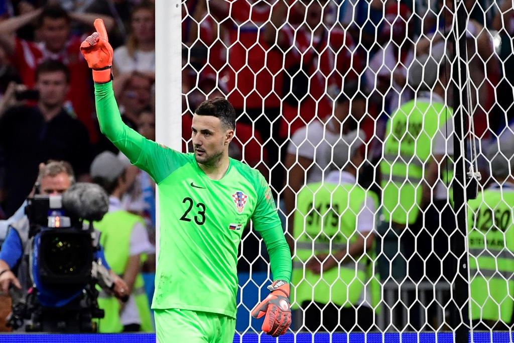 Aksi kiper Kroasia Danijel Subasic usai menggagalkan eksekusi penalti pemain Rusia di babak perempat final (Foto: AFP PHOTO / PIERRE-PHILIPPE MARCOU)