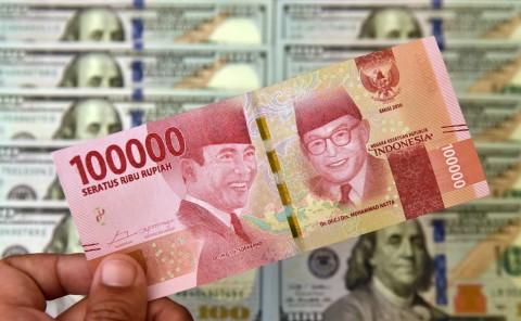 Rupiah Diprediksi Bergerak ke Rp14.395-Rp14.369/USD
