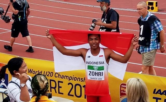 Lalu Muhammad Zohri merayakan kemenangannya dalam IAAF World Junior Championships di Tampere, Finlandia, Rabu (11/7/2018). Kemenpora RI/IAAF