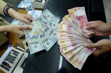 Rupiah Mendekati Rp14.500/USD