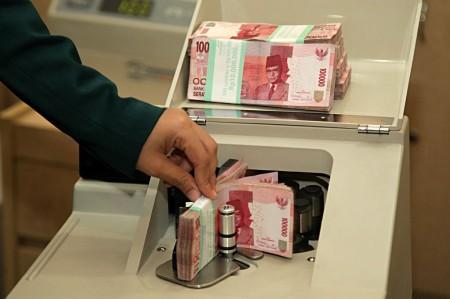 Rupiah Tembus Rp14.530/USD
