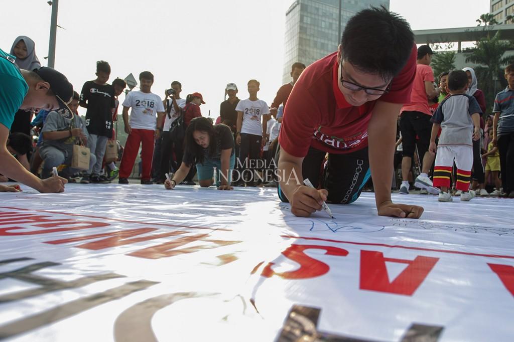 Aksi Pengunjung CFD Dukung Atlet Indonesia di Asian Games