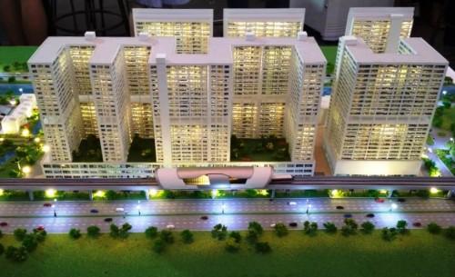 Maket salah satu proyek apartemen TOD yang dikembangkan Adhi