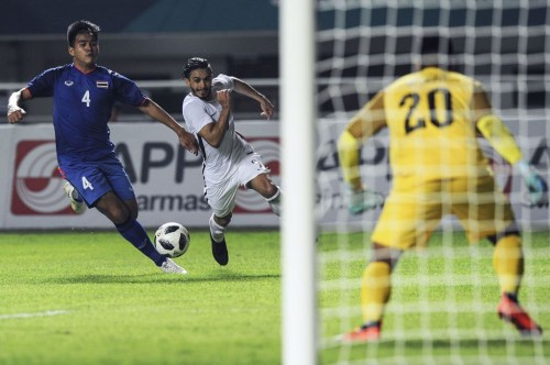 Timnas Qatar vs Thailand. (Foto: AFP/Chaideer Mahyuddin)