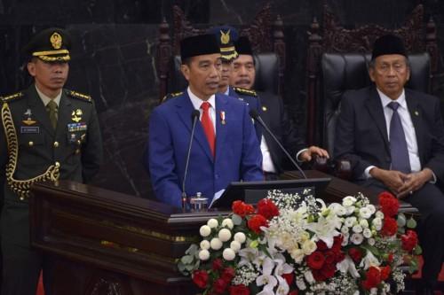 Presiden Joko Widodo saat membacakan nota keuangan. (FOTO: AFP)