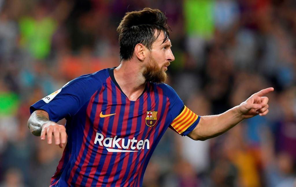 Lionel Messi menyumbang dua gol untuk Barcelona saat menghadapi Deportivo Alaves (Foto: AFP/Lluis Gene)