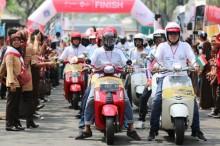 Komunitas Vespa Bangga Kawal Obor Asian Games 2018