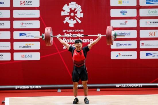 Sabet Emas Perdana di Angkat Besi, Eko Yuli Kalahkan Batas di Asian Games 2018