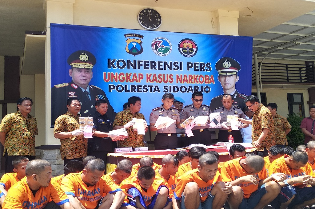 Polres Sidoarjo merilis penangkapan 29 tersangka peredaran narkoba selama dua pekan, Jumat 14 September 2018, Medcom.id - Hadi