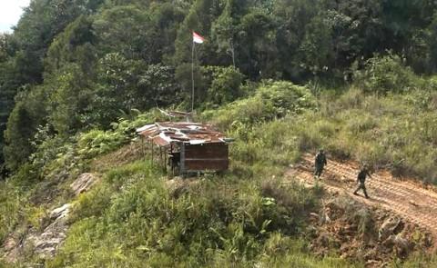 Pos jaga di perbatasan RI-Malaysia di Desa Nanga Seran,